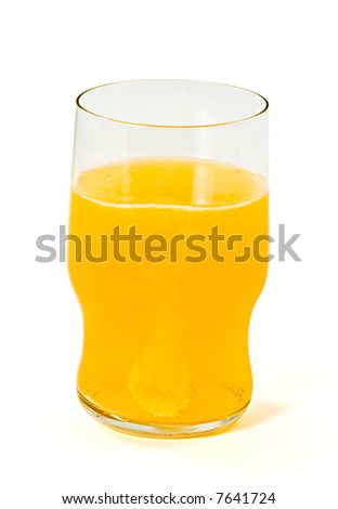 Glass with a orange sparkling tablet on white