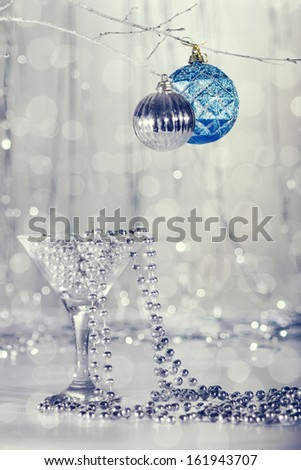Glass with beads, Christmas tree ornaments.