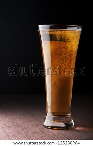 Glass with beer on the table