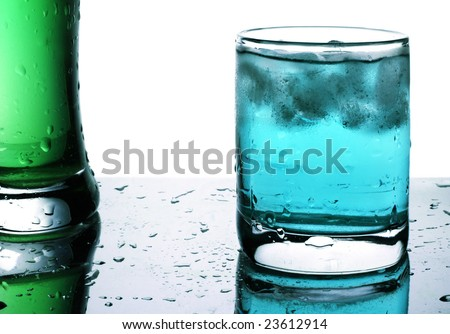 Glass with blue beverage and ice