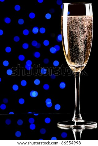 Glass with champagne on abstract color background