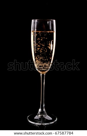Glass with champagne on black background