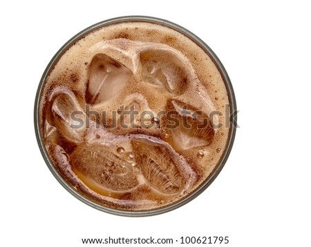 Glass with cola with froth and ice, above view