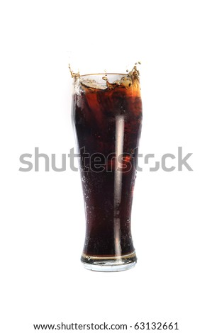 glass with cold drink costs on table