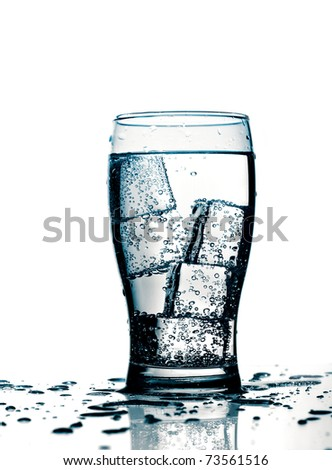 glass with cold purified water and ice, over white background