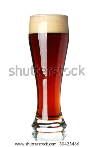 Glass with dark beer on a white background