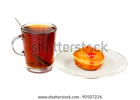 Glass with donuts isolated on white background