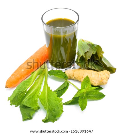 Glass with fresh Various Freshly Vegetable Juices for Fasting isolated on white background. Green juice with the sweetness from carrot.
