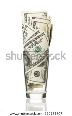 Glass with heap of dollars isolated on a white background