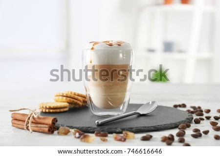 Glass with latte macchiato on blurred background #746616646