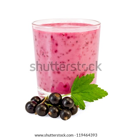 Glass with milkshake, berries and a green leaf of a black currant it is isolated on a white background