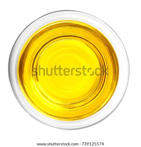 Glass with oil on white background