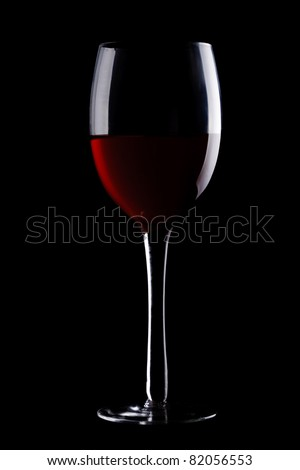 Glass with red wine isolated on black