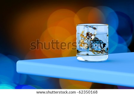 Glass with vodka on the table for a party