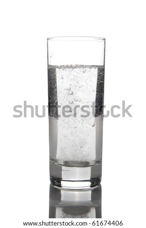 Glass with water and a effervescent tablet
