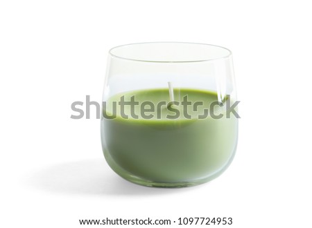 Glass with wax candle on white background #1097724953