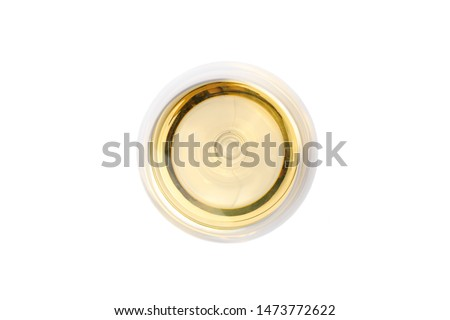 Glass with white wine isolated on white background, top view