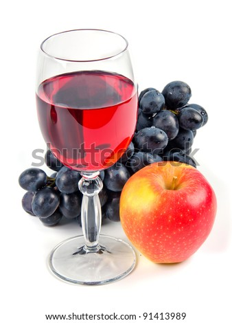 glass with wine and fruit on white background