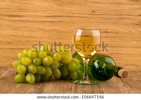 glass with wine on a wooden table #106647146