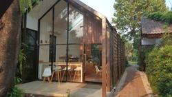glass wooden house sideyard garden
