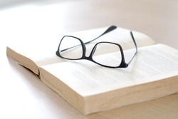 Glasses and books placed on table in the living room .Educational concepts and knowledge