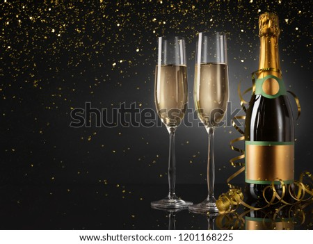 Glasses and bottle of champagne on shiny background #1201168225