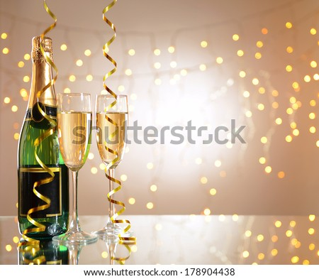 Glasses and bottle of champagne on shiny background #178904438