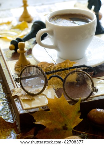 Glasses And Cup Of Coffee On Chess Board With Chessmen On