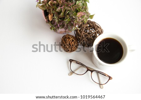 Glasses and floral on white shot overhead. #1019564467