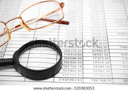 Glasses and magnifiers on the documents.