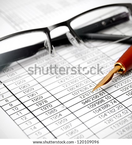 Glasses and pen on documents.
