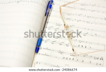 Glasses and pencil on book of notes