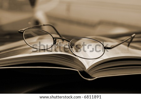Glasses and the Magazine - Close Up - stock photo