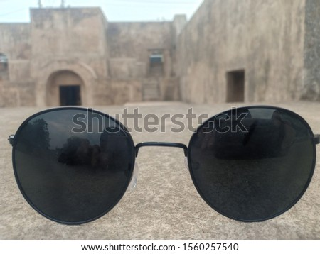 Glasses are thin lenses for the eyes in order to normalize and sharpen eyesight (some framed and some not) Now in addition to visual aids, glasses have become a complementary style.