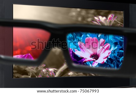 Glasses 3D in front of the TV with a flower. 3D television.
