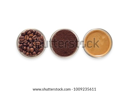 Glasses filled with coffee beans, ground coffee and freshly brewed espresso.