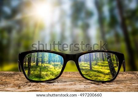 glasses focus background wooden ...