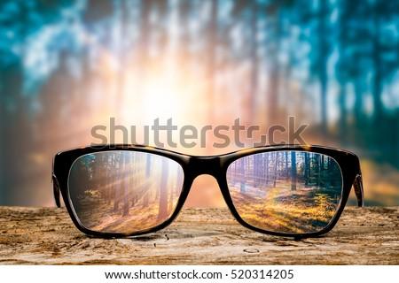 glasses focus background wooden eye vision lens eyeglasses nature reflection look looking through see clear sight concept transparent sunrise prescription sunset vintage sunny sun retro - stock image Foto d'archivio ©