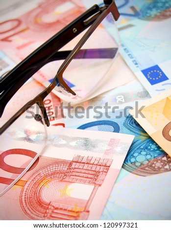 Glasses for euro banknotes. - stock photo