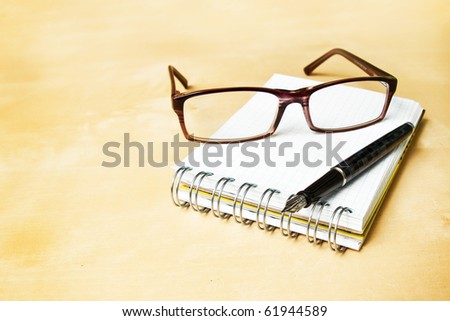 Glasses fountain pen notebook in composition in color