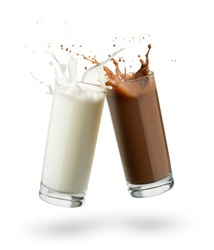 glasses full of milk and chocolate jumping and splashing on white background.