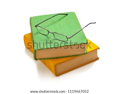 free photos hard covered books and eyeglasses on it isolated on