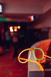 Glasses made of glowsticks on a night party