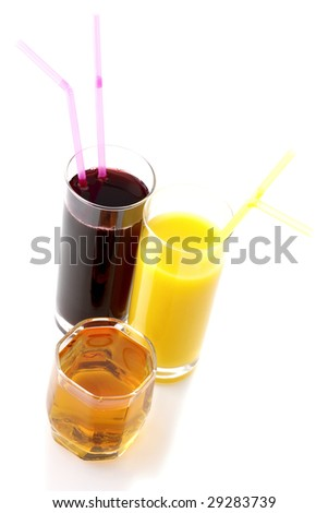 Glasses of apple, orange and grape juices on white background.