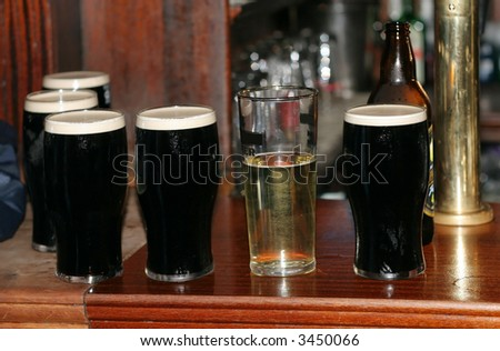 glasses of beer on top of bar
