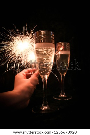 glasses of champagne and fireworks #1255670920