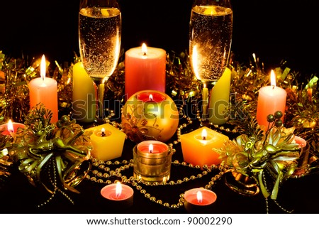 Glasses of champagne and lots of candles.