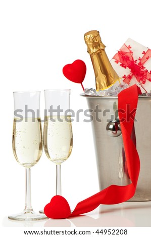 Glasses of champagne for Valentines day with heart and ribbon decoration