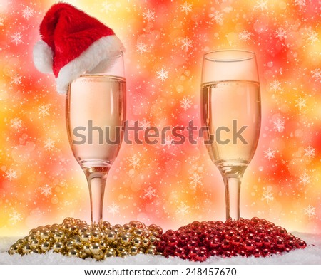 glasses of champagne gold and red pearls, Christmas concept