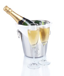 Glasses of champagne in pail, isolated on white